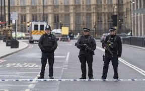 Police cordon off the area near Parliament in London where an assailant attacked a police officer and pedestrians.