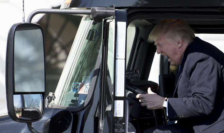 US President Donald Trump sits in the drivers seat of a semi-truck as he welcomes truckers and CEOs to the White House in Washington, DC, to discuss healthcare.