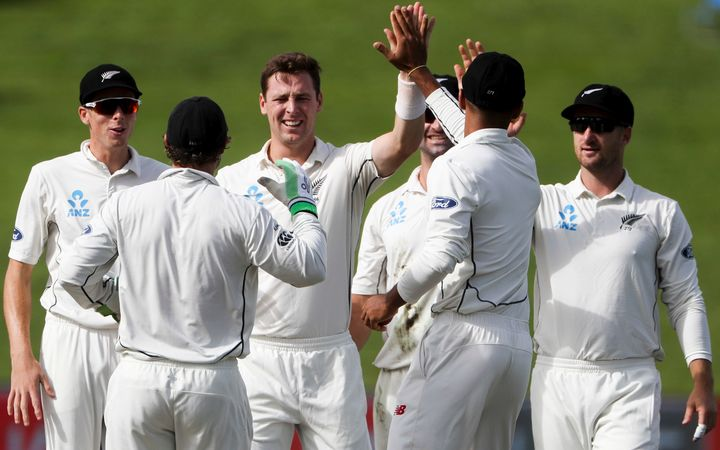 Matt Henry celebrates the wicket of South Africa's Temba Bavuma.
