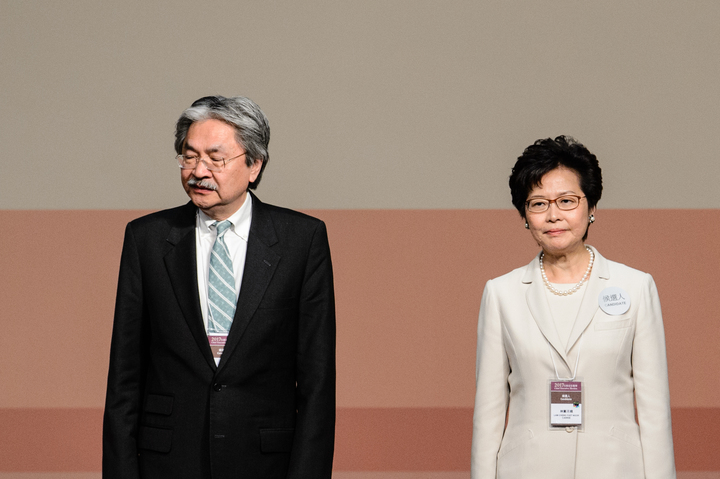 Carrie Lam and her defeated opponent John Tsang.