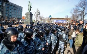 Russian riot police detain protesters during an opposition rally on March 26, 2017 in Moscow.