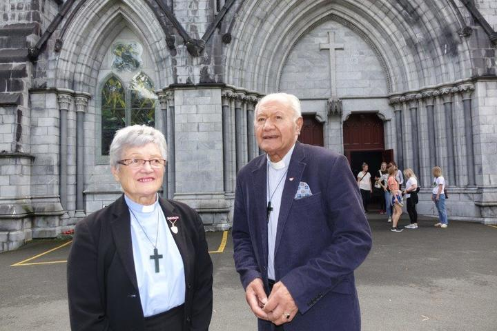 Archdeacon Andy Joseph and his wife, Ramari Joseph, also an Anglican priest outside the cathedral which is one of Nelson's top ranked tourist attractions.