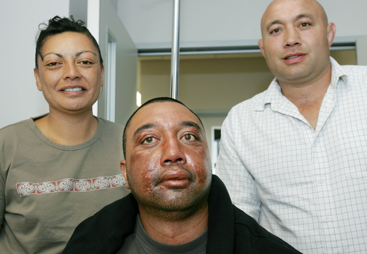 Rob Hewitt, centre, the day after his sea ordeal ended on February 8, 2006, pictured with fiancee Rangi Ngatai and brother Norm Hewitt.