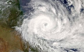 Cyclone Debbie can be seen closing in on the Australian coast in this NASA image.