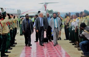American evangelist Doug Batchelor (centre) is welcomed to Papua New Guinea's Mt Hagen by MP Don Polye (light suit, white tie), surrounded by saluting Seventh Day Adventist youths
