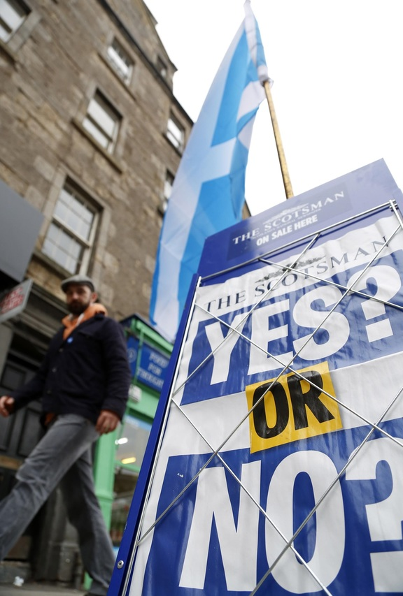 """Yes or No"" poster is seen during voting for Scottish independence referendum on September 18, 2014 in Edinburgh, Scotland. Scottish voted against becoming independent from Britain in a referendum."