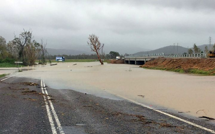 Flood waters submerging part of a highway near the Cyclone Debbie-hit Bowen area in Queensland.