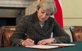 UK Prime Minister Theresa May signs the letter that will trigger Brexit.