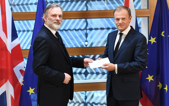 Britain's ambassador to the EU Tim Barrow delivers the formal notice of the UK's intention to leave the bloc to European Council President Donald Tusk in Brussels on March 29, 2017.