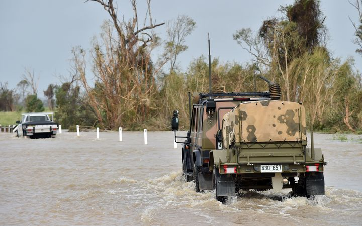 An army vehicle drives through floodwaters near the Queensland town of Bowen on Wednesday.