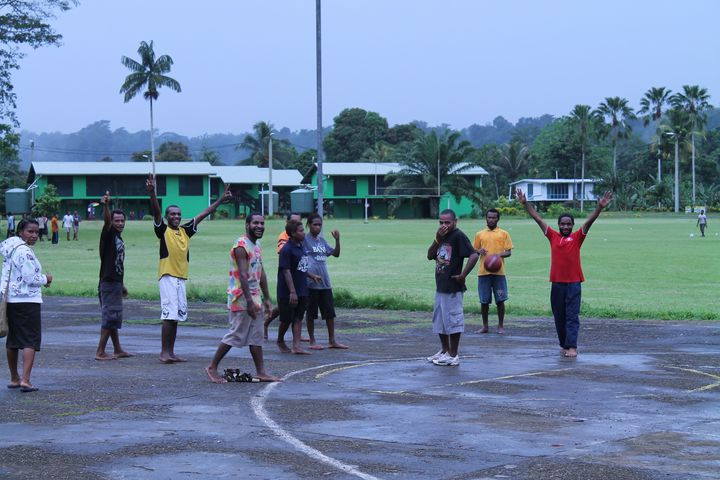 Students playing basketball at Kerevat National High School.