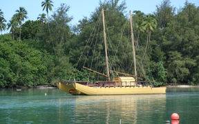 Traditional vessel at anchor in the channel leading to Rarotonga's Muri lagoon, Cook Islands