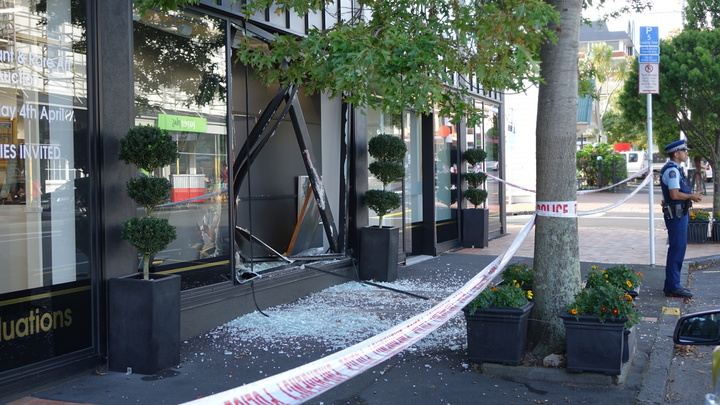 Glass can be seen littering the street at the International Art Centre, in Parnell, after the ram-raid in which two Gottfried Lindauer paintings were stolen.