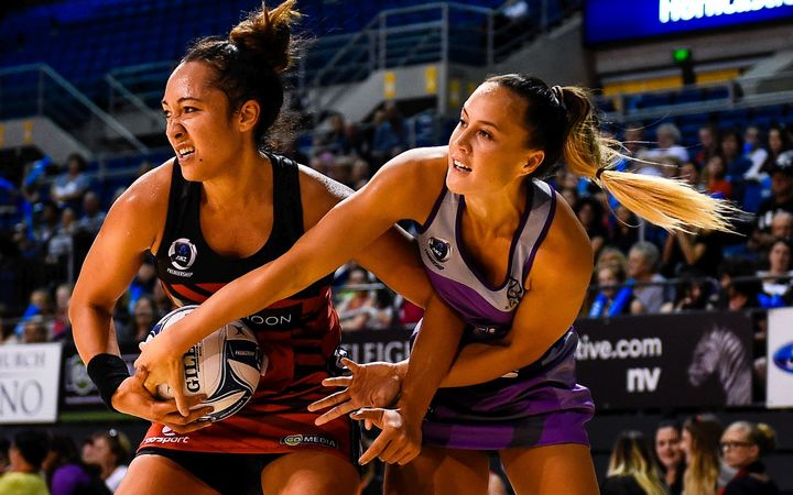 Erikana Pedersen of the Tactix and Courtney Tairi of the Northern Stars battle for the ball.