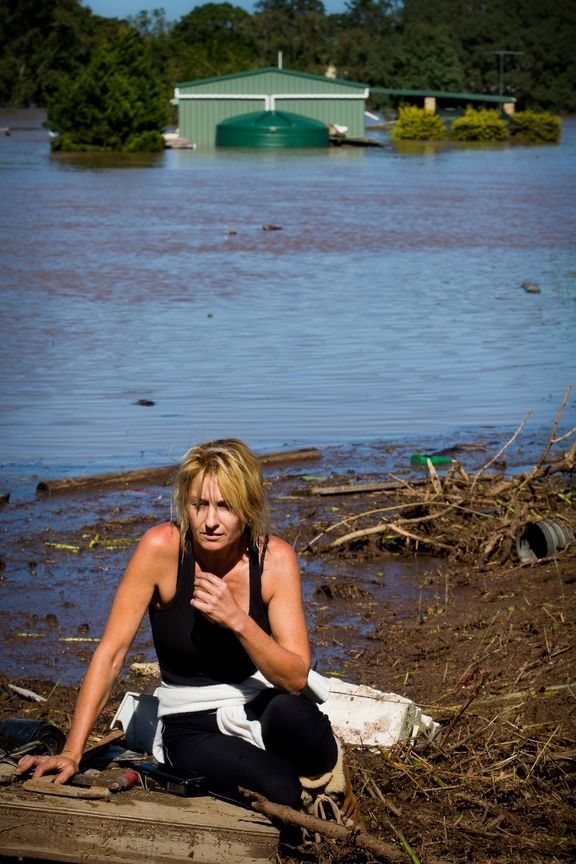 Cassey Bentley reacts to the discovery of her flooded home in North MacLean, Brisbane on April 1, 2017, which was submerged under floodwaters caused by Cyclone Debbie.