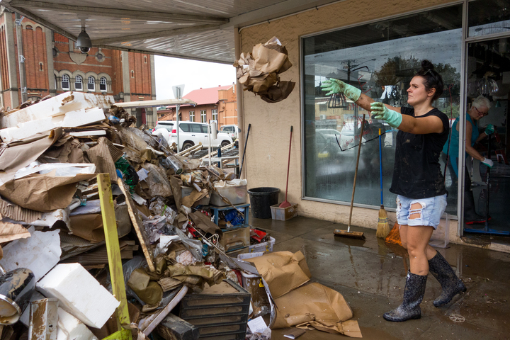 The cleanup begins in central Lismore in the wake of flooding as ex-cyclone Debbie made its way south across the country.
