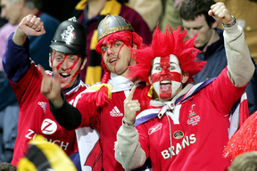 British and Irish Lions fans celebrating their team's victory against Taranaki in New Plymouth during their tour of New Zealand in 2005.