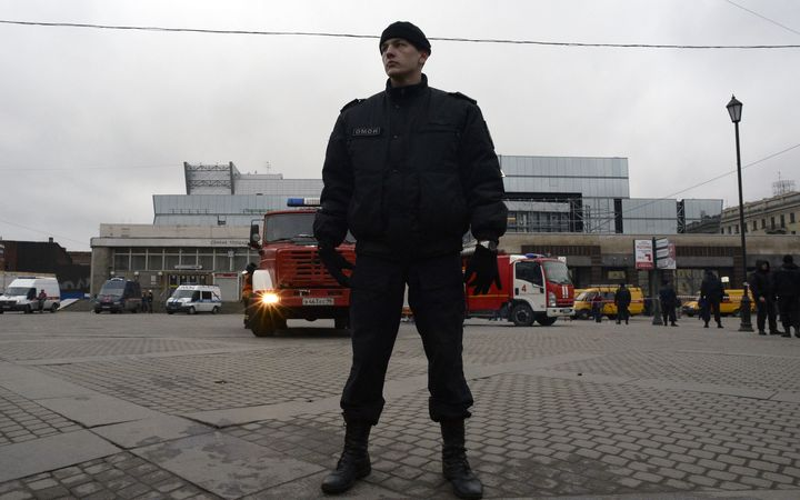 A riot police officer guards the area next to the entrance to Sennaya Square metro station in Saint Petersburg.