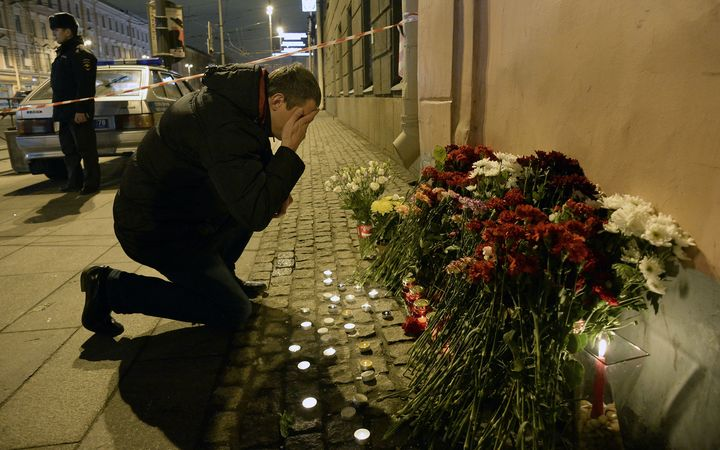 A places flowers in memory of victims of the blast in the Saint Petersburg metro outside Technological Institute station.