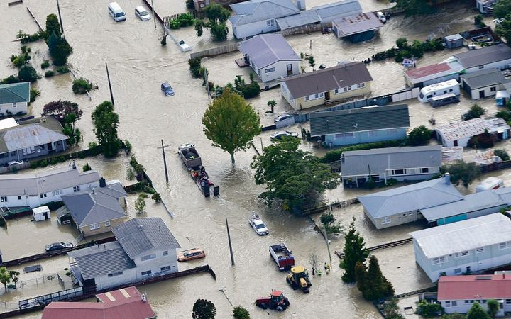 Agricultural vehicles help evacuate Edgecumbe people to welfare centres established in Whakatane and Kawerau.