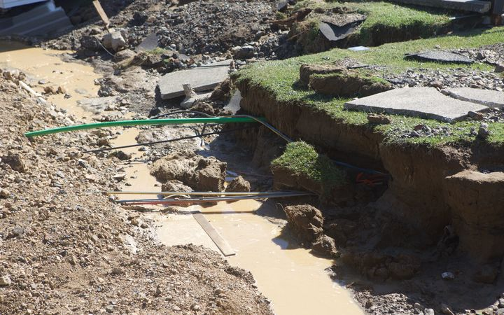 Floodwaters tore out huge chunks of the ground around the Edgecumbe homes.