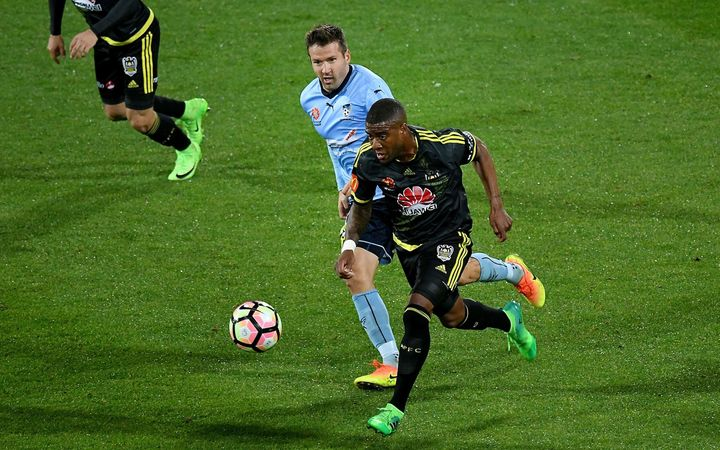 The Phoenix's Rolieny Bonevacia (front) dribbles the ball with Sydney FC's Milos Dimitrijevic during their A-League football match at Westpac Stadium in Wellington.
