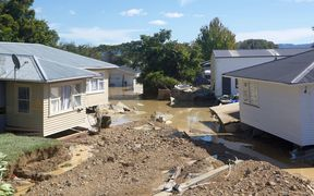 Severely damaged houses in Edgecumbe, after floodwaters tore through the Bay of Plenty town.