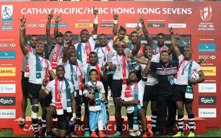The Fiji team celebrate a third consecutive Hong Kong title