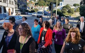 People marching for pay equity for women in Wellington this morning.