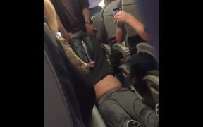 A screengrab from footage of the passenger being dragged from the plane.