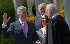 US President Donald Trump (C) watches as Justice Anthony Kennedy (R) administers the oath of office to Neil Gorsuch