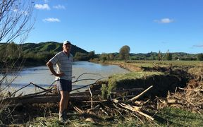 Kevin Clark next to some of the flood damage on his property next to the Waimana River.