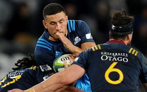 Sonny Bill Williams in his Blues jersey with the BNZ logos taped over on the collar.