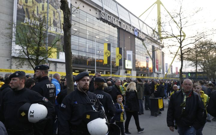 Police patrol outside the stadium after an explosion of the team bus of Borussia Dortmund.
