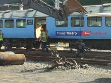 Mangled pieces of the train are removed at the Wellington station.