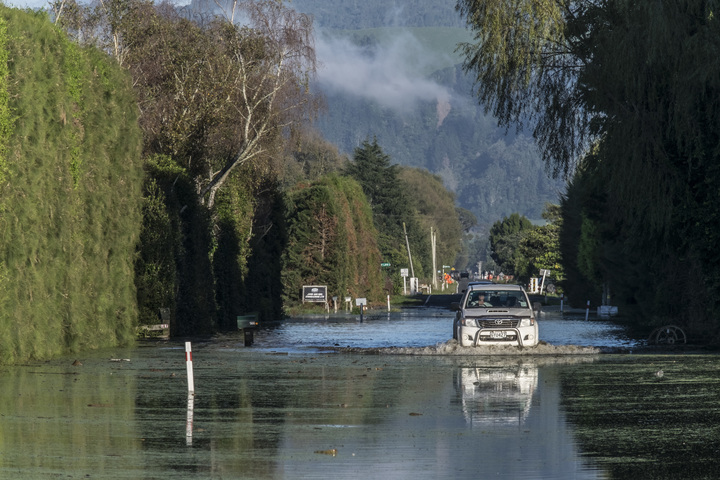 A farmer drives through flood waters on Otaiki Road the morning after the town of Edgecumbe was flooded by a burst stopbank.  Friday 7 April 2017