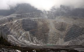 Tthis photograph taken on August 16, 2013 shows a general view of the Freeport McMoRan's Grasberg mining complex, one of the world's biggest gold and copper mines located in Indonesia's remote eastern Papua province.