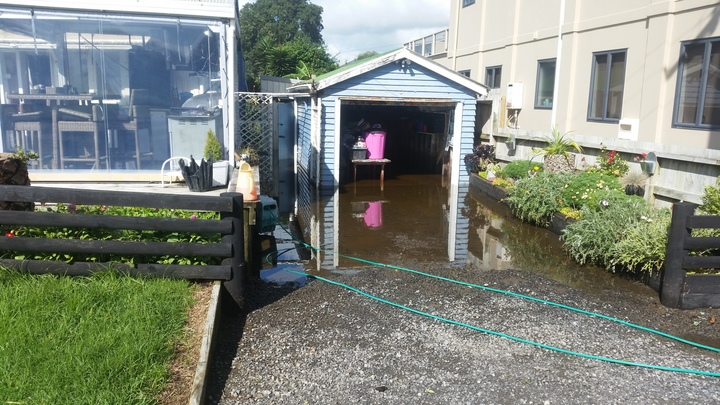 Flooding at a Waihi Beach property.