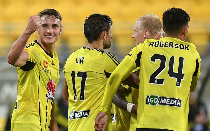 Phoenix's Dylan Fox (L) celebrates a goal during the A-League - Phoenix v Newcastle football match.