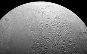 Enceladus, to the north are craters and evidence of the many impacts the moon has suffered in its history.