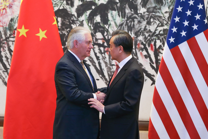 China's Foreign Minister Wang Yi (R) shakes hands with US Secretary of State Rex Tillerson after a joint press conference at the Diaoyutai State Guesthouse in Beijing on March 18