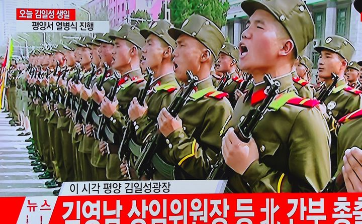 A television screen broadcasting live footage of the ceremony to mark the 105th anniversary of the birth of North Korea's founder Kim Il-Sung.