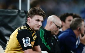 Beauden Barrett  looks on from the sin bin after being yellow carded.