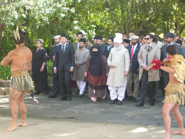 His Holiness Mirza Masroor Ahmad, wearing white, was welcomed onto the marae.