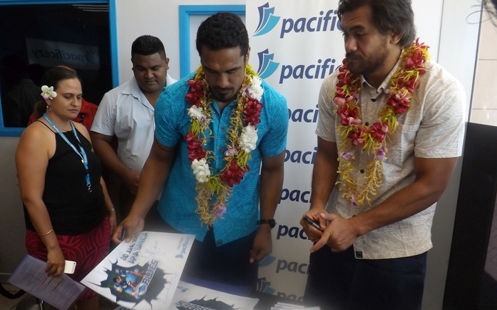 Blues loose forwards Jerome Kaino and Steven Luatua at a signing session in Samoa.