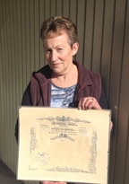 Jean Cretney from Carterton holding the certificate recording the death of her uncle George Carswell.