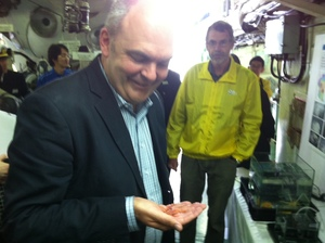 Science and Innovation Minister Steven Joyce holds one of species found near underwater mountains in the northern Kermadec Arc.