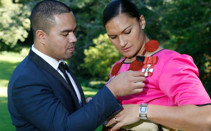 Dame Valerie Adams and her husband Gabriel Price at her investiture during the week.