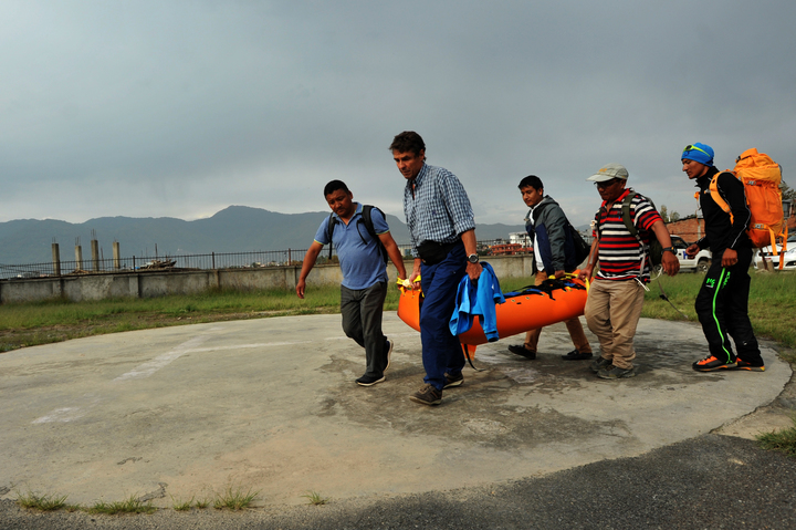 Nepalese volunteers and friends of Swiss climber Ueli Steck carry his body at a hospital in Kathmandu after it was recovered by helicopter.