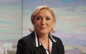 French presidential election candidate for the far-right Front National (FN) party, Marine Le Pen poses prior to an interview on the prime time evening news broadcast of French private television channel TF1, on May 2, 2017 in Boulogne-Billancourt, near Paris